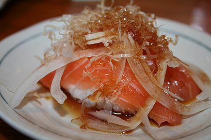 I can't go to a sushi restaurant without ordering something with salmon in it! The thinly sliced onions gives this salmon sushi a nice kick.
