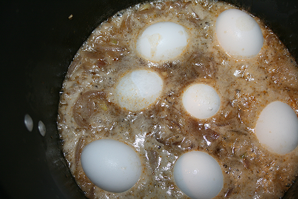 Once the pork gets brown, add the 2 cans of CoCo soda and half a dozen eggs. Daniel wanted to boil the eggs in the liquid, but I've seen it boiled separately. It's all preference, I guess.