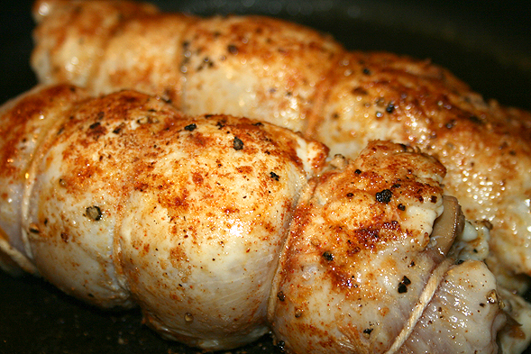 Secure the chicken with butcher's twine, making sure none of the stuffing will fall out. Season the outside with the same as above, then sear chicken for about 2-3 minutes on each side over high heat. Then, put in the oven at 350 degrees for about 10-12 minutes or until chicken is fully cooked.