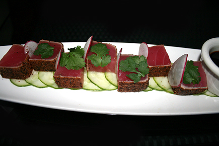 Pepper seared ahi tuna with cucumber, soy, ginger, and wasabi.