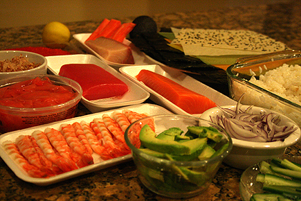 Our kitchen island was transformed to a sushi bar. This is what we purchased: salmon, tuna, yellowtail, shrimp, roe, imitation crab, sushi rice, nori, soy paper, avocadoes, bonito flakes, cucumber, sweet ginger, ponzu sauce, and of course, wasabi.