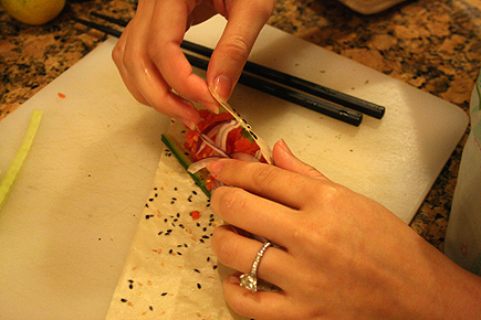 Attempting to make the spicy tuna handroll. I was winging it because I had no directions in front of me.
