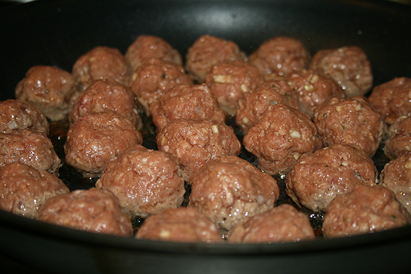 We made the meatballs by combining about 2 lbs of ground beef (leaner the better), 1/2 cup of breadcrumbs, 2 eggs, 1 cup of beef broth, garlic, shallots, salt & pepper. Roll them into small balls and pan fry them until they're brown and cooked through.