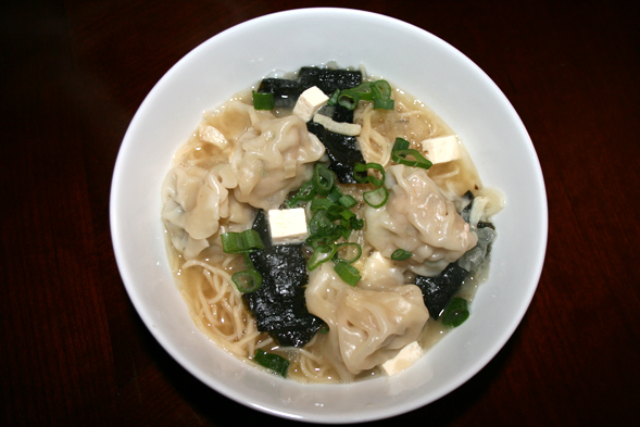 We boiled egg noodles separately, then added it to our wonton soup. The soup consists primarily of chicken stock, miso paste, tofu, seaweed, and topped with green onions.