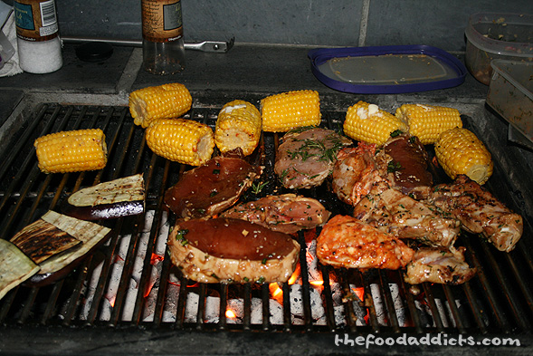 Looks like this is one happy BBQ grill. We couldn't forget corn on the cob and some grilled eggplant!