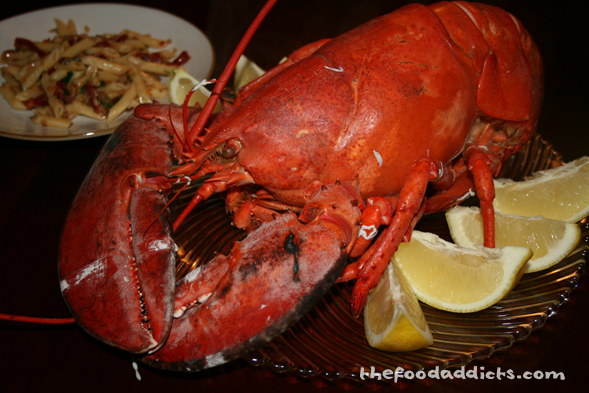 After 22 minutes in boiling water, we took the lobster out and prepared to feast on it. It doesn't get better than this!