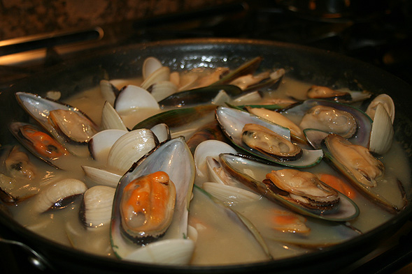 First, we sauteed a lot of garlic and butter, then added the clam juice. Once it comes to a boil, we thickened up the juice by adding a little bit of cornstarch. Add in the mussels and clams and let it hang out for about 10 minutes or until the clams start opening.