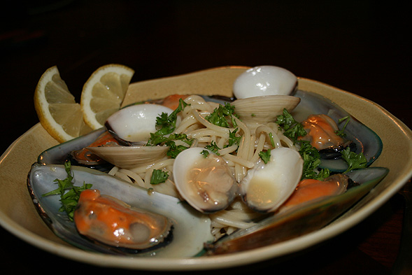 Add some parsley and a fresh squeeze of lemon onto your hot plate of pasta and seafood - and dig in!