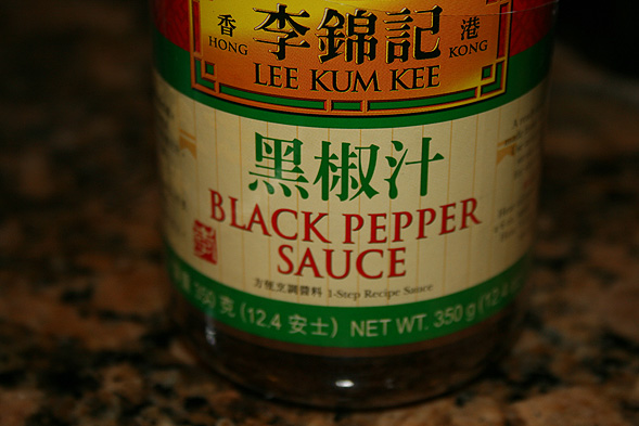 Then take a few scoops of Lee Kum Kee's Black Pepper Sauce and toss it together with the pork for a few minutes.