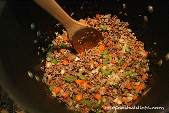 Start by browning 2 lbs of ground beef in a large pot (remove excess fat if desired). Then saute diced onions, celery, carrots, and garlic. Season with salt and pepper. 