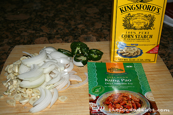 "Getting all of our ingredients ready for the pan - garlic, onions, chili, cornstarch, and of course, the ""Asian Home Gourmet"" spice paste."