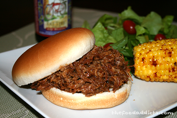 Here is the finale of the 3-hour cooking process! This mouth-watering BBQ pulled pork sandwich will make anyone a happy camper. Enjoy with a refreshing bottle of Fat Tire beer!