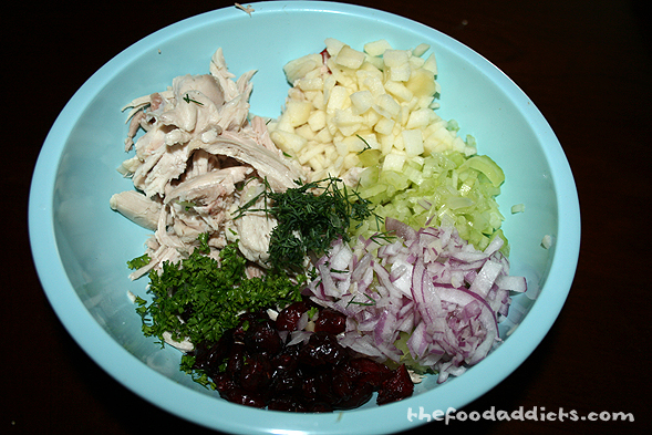 Since I still had extra chicken, I decided to make something else for lunch the next day - a chicken salad sandwich. In a mixing bowl, combine chicken, diced apples, celery, red onion, dried cranberries, parsley, and dill.