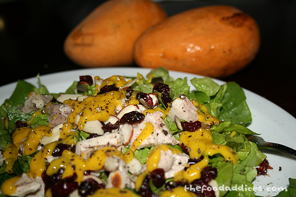 I got some salad from the garden, and added the chicken, dried cranberries, sliced almonds, and drizzled the mango dressing on top. The dressing isn't sweet like you think - it's got a tangy kick from the rice vinegar. Overall, it's not too shabby!