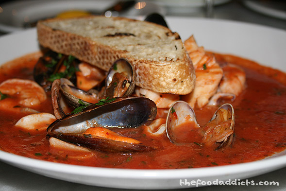 His dinner entree was the Cioppino, which is a classic Italian dish with clams, mussels, fish, shrimp, and calamari in a spicy tomato sauce. You just have to be careful when eating this to not splash it all over your shirt!