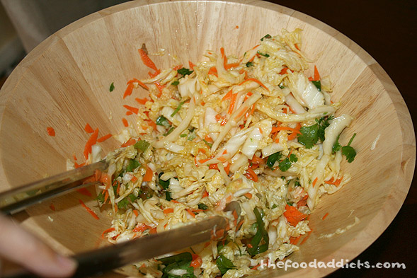 To the dressing, add 1/2 small head shredded Savoy or green cabbage, 1 cup fresh cilantro leaves, 4 scallions, 1 grated carrot, and 1/2 fresh jalapeno, minced. Toss together to combine. 