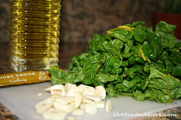 To go along with the pork chops, we cut some swiss chard in the backyard and sauteed it with olive oil, garlic, and some turkey stock.