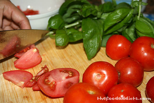 Next, chop up your tomatoes and basil and throw it into a small bowl. Doesn't it look gorgeous?