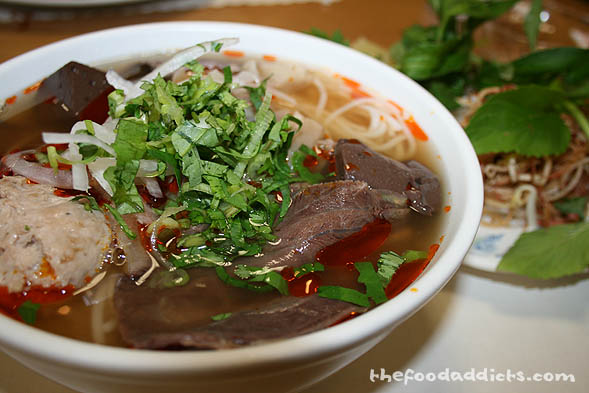 One of the most famous dishes that originated from Central Vietnam is this here: Bun Bo Hue. It's a soup dish that combines spicy beef and pork with vermicelli, herbs, and thinly sliced banana blossoms. The broth is completely different from Pho because of the large variety of different spices which includes lemon grass and chili. We shared this bowl at Huong Giang Restaurant which is known for their Central Vietnamese cuisines.