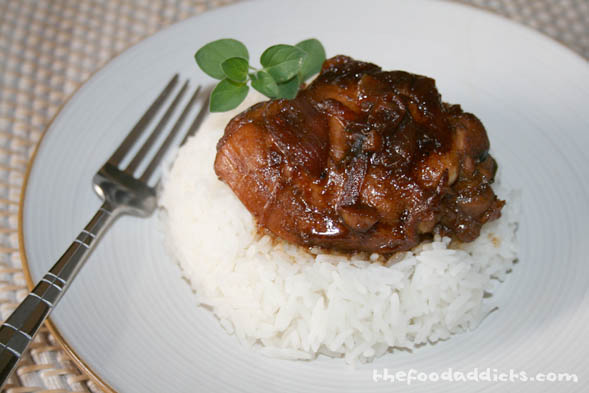 Generally, people like to make pork adobo, but this is the healthier alternative. What makes this Filipino dish different from regular soy sauce chicken is the addition of vinegar. And of course, it's almost always eaten with white rice. Thanks for the recipe, Larry! It was great!