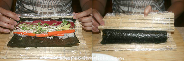 Holding the line of ingredients with your fingers, push up and turn over the end of the bamboo mat closest to you with your thumbs, so the edge of the nori meets the rice on the other side of the filling. Lift up the top of the mat and continue to roll, so the strip of nori on the top side is now on the bottom. Squeeze gently to firm and shape the roll.