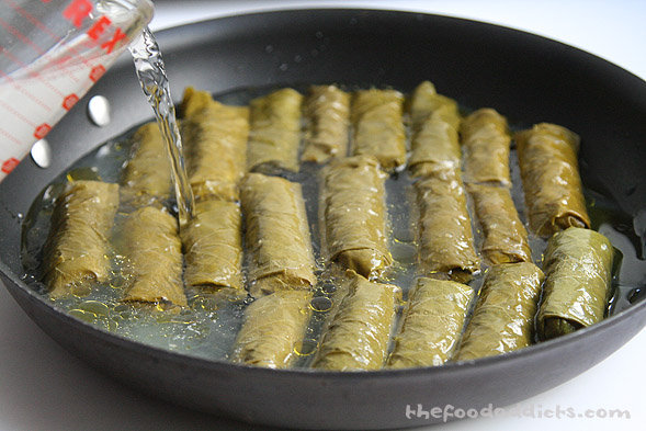 In a large pan, place the 20 Dolmades down and pour in 1/2 cup lemon juice, 2 tbsp olive oil, and just enough water to fill the grape leaves. You can also use chicken stock. 