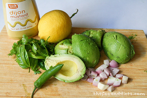 Meanwhile, prep the ingredients for the avocado puree. This will include 3 medium-sized avocados, 1 shallot, half a garlic clove, 1 tbsp parsley, 1 tsp basil, 1/2 serrano pepper, 3 tbsp lemon juice, 1 tbsp dijon mustard, and 3 tbsp olive oil.