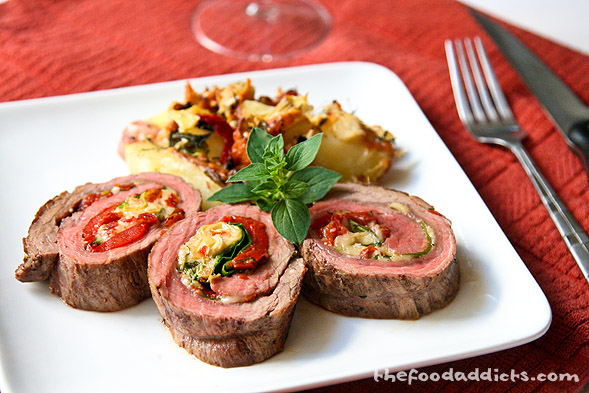 We paired the Flank Steak Roulade with a side of roasted potatoes with similar toppings and a glass of Beringer Cabernet Sauvignon 2008. The sweet notes from the wine paired perfectly with the sweetness of the roasted red peppers and acidity from the artichokes.&amp;nbsp;It's surely a pretty presentation of colors and flavors that will tickle your fancy. Keep in mind that you can always choose different ingredients to fill the meat! We enjoyed our creation of this Flank Steak Roulade, but next time we're going to step it up a notch and make a demi glace sauce to go on top. Yum! 