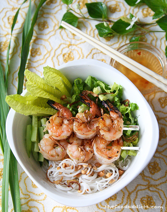 "Get your favorite nước chấm fish sauce and chopsticks and dig in to this bowl of Grilled Lemongrass Shrimp and Vermicelli with fresh herbs and veggies, sprinkled with fried shallots and crushed peanuts. Remember you can always add other popular ingredients, like bean sprouts and shredded carrots. For the meat-lovers, this dish can be accompanied with more grilled meat or eggrolls. They will all taste fabulous together. If you decide this is all too much work, just pop into your local Vietnamese restaurant and order this on the menu ""Bun Tom"" which means Vermicelli with Shrimp. I suggest going all-out and getting the combination bowl with everything! Eat your heart out. Hope we gave you a good idea on what to whip up for lunch or dinner this summer. When rice gets boring, go for vermicelli! (Eat a lot, or you'll be hungry later, haha). :)"