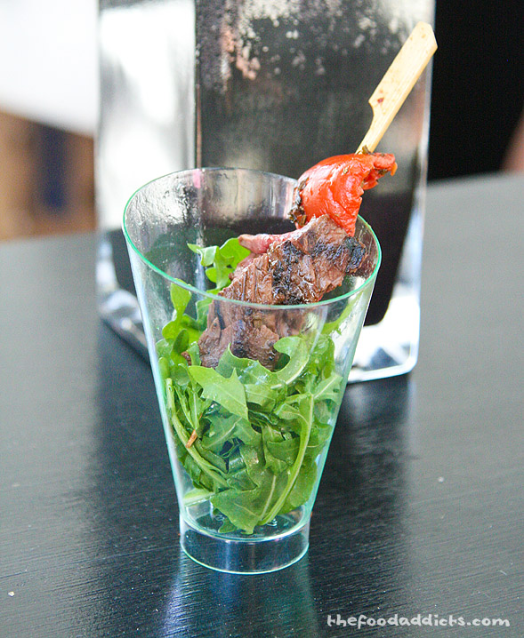 Here we have the 'Cumin spiced skirt steak on roasted tomato and arugula' from Simon LA.