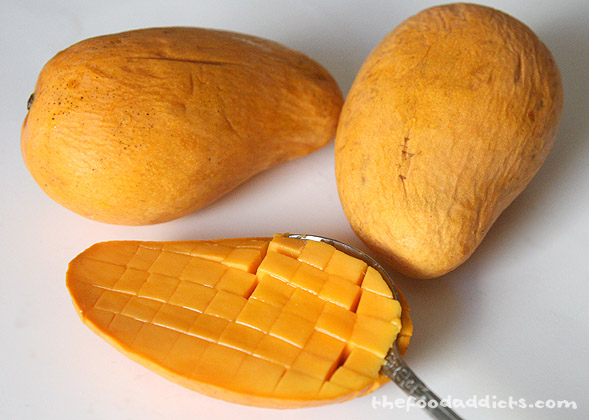 My mom always gives me mangoes when I come visit, so let's just say I always have a few of these on hand. The best way to cut these up quickly with little mess is to halve the mangoes and cut them into little squares. Then take a spoon and scoop it out. No chopping required!
