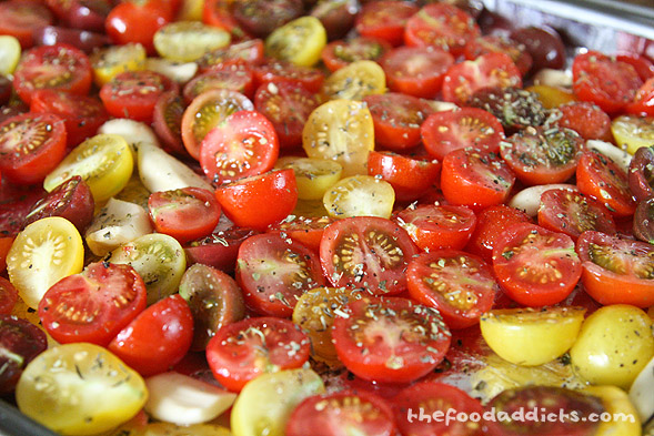 On a baking sheet, we halved our cherry tomatoes along with garlic cloves and drizzled it with extra virgin olive oil and sprinkled a blend of Italian seasonings on it with some salt and pepper. We popped it into a 225-degree oven and slowly dried it for about 3-4 hours. The time will depend on how juicy your tomatoes are. Just keep an eye on it every so often.
