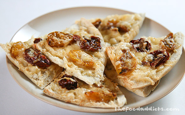 We made little appetizers to eat with our home-made Oven-Dried Cherry Tomatoes. We simply took a pita bread and cut them into triangles, then added freshly grated smoked gouda cheese and topped it with the tomatoes. We crisped up the bread and melted the cheese in a toaster oven to achieve a delectable appetizer to enjoy. 