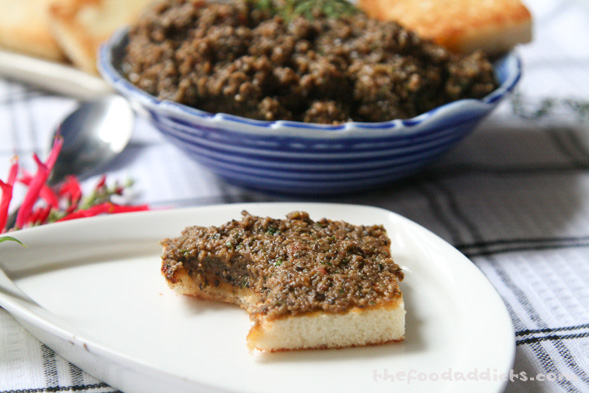 This batch yields about 1 1/2 cups of Roasted Garlic and Olive Tapenade, so it's perfect to bring to parties or have as an appetizer for your own events. As you can see, it's very easy to make; in fact, if you don't care for the roasted garlic portion of the recipe, just add 1-2 fresh garlic cloves into the processor with the olive oil. Either way, the end result is going to taste fabulous. You get the saltiness with the capers and anchovies, the freshness of the herbs, garlic, and sun-dried tomatoes, the sourness from the lemon juice and red wine vinegar, and of course, the boldness of the olives.It's a great combination that you can enjoy in so many ways - as a spread on the crusty bread or crackers, as a dip with chips, as a condiment with vegetables or chicken, or even tossed with cooked pasta!