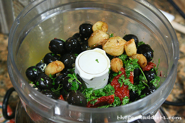 All of the ingredients goes into a food processor, along with the roasted garlic and olive oil.